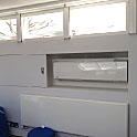 Toshiba high wall heat pump in architectural cabinet - London